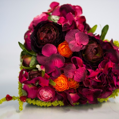 Funeral flowers of dark reds and pinks