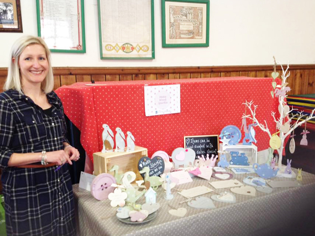 One of our stall holders and her wooden hearts